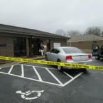 Authorities Gather Evidence at Bank Robbery Scene